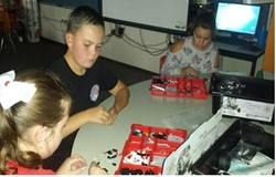 This is a picture of a student working with LEGOs.